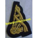 Band Pipe Arm Badge In Gold