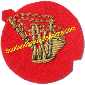 Bagpipe Gold On Red Badge